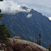 After the windstorm, before the clearing- goats hugging the rocks on a breezy morning in front of Mt. Stuart.