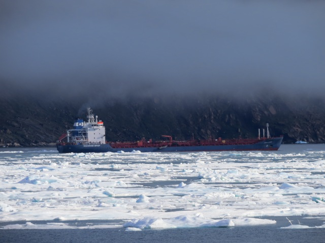 A tanker of fuel in Pangnirtung Fiord, skirting ice