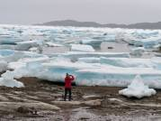Ruth photographing icebergs in Iqualuit Harbor